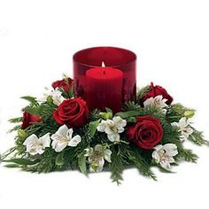 Your holiday will sparkle once you light the candle inside this glass hurricane surrounded by velvety roses. Send it now for only $66. For more please visit http://www.flowers2world.com/send_flowers_online/flowers_gifts_argentina.asp