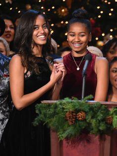 Malia and Sasha Obama at the TNT Christmas in Washington Special in 2014