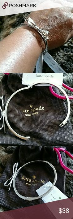 """???? Kate Spade New York Bow Bangle Bracelet ?? Authentic Brand New With Tags Kate Spade New York Large Bow Bangle Bracelet. Super Adorable!! Silver Hardware With Hinged Closure. Size Is 2.25""""(D). Comes With A Kate Spade Pouch. Super Fast Shipping!! kate spade Jewelry Bracelets"""
