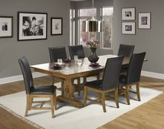 Kenosha Dining Sets.  Whether you favor rustic, country or transitional design, the Kenosha's eclectic nature satisifies scores of design styles.  Solid White Oak with a distressed finish and leather dining chairs.  Available at Just Cabinets Furniture & More and online at JustCabinets.com