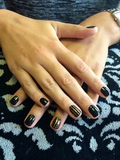 Black & gold glitter nail art design with stripes in shellac by Evie at Tranquility Spa Hornchurch, Essex x