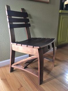 Dining chair made from oak Wine Barrel Staves. Red wine stain shown on seat and back. This chair is very solid and comfortable. Before placing an order please send email with Zip code to determine shipping charges. Wine Barrel Chairs, Whiskey Barrel Furniture, Luxury Office Chairs, Barris, Rustic Wood Furniture, Most Comfortable Office Chair, Patio Chair Cushions, Chairs For Sale, Chair Design