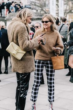 Spotted on the streets of New York, London, Milan and Paris, fur and feather shoes are everywhere this season. We love this tartan suit street style look..