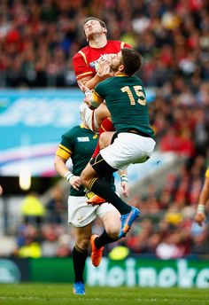 Dan Biggar of Wales wins a high ball under pressure from Willie Le Roux to set up a first-half try for Gareth Davies