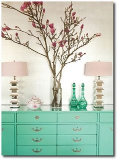 Pink Magnolia branches and turquoise dresser