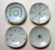 set of four appetizer plates