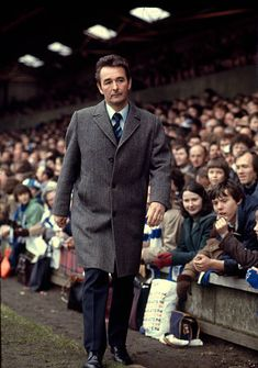 03 March 1979 Football League Division One - Ipswich Town v Nottingham Forest, Forest manager Brian Clough walks to the dugout at Portman Road wearing an overcoat. Brian Clough, Nottingham Forest Fc, Ipswich Town, Tv Shows, Soccer, Vintage Sport, Football, Division, Walks