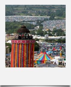 A sea of people at The Glastonbury Festival.  A stunning 6 day, 60-something stage experience, complete with a circus!