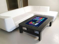 Who doesn't want a Giant Coffee Table Touchscreen Computer? I'll take one yes please.  and if I have kids, they can be crushed under it's powerful pc legs!  THIS  IS  QUADCORE!!