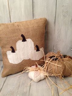 Add some rustic charm to your fall decor. This sweet white pumkin trio pillow is made from recycled burlap and recycled sweaters. The sweaters are hand cut into a pumpkin shapes and appliqued to the b                                                                                                                                                                                 More
