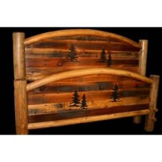 Recycled barn wood with a carved pine tree design is framed by arched lodge pole pine logs on this exceptional log bed. The Pine Trio Arched Barn Wood Beds are finished with a clear coat to enhance the beauty of the wood. Rustic Log Furniture, Cabin Furniture, Bedroom Furniture, Cedar Table, Tree Carving, Rustic Bedding, Wood Bedroom, Wooden Crafts, Log Homes