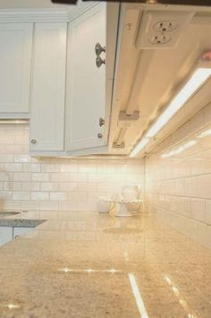 Install your outlets underneath your cabinets so you don't ruin your backsplash.