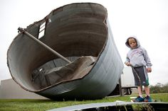 Week of May 31 - Jun 6, 2014  Four-year-old Lane Loftis stands near a grain bin near Craig, Neb., after a severe storm that passed through the region the previous evening. Craig and other cities were pounded by large hail as powerful thunderstorms moved through the Midwest. Julia Nagy/The Omaha World-Herald/Associated Press