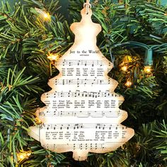 Celebrate the Christmas season with this Christmas tree Christmas music ornament! LISTING INCLUDES - One (1) ornament FEATURES - lightweight wood - about 5 5/8 tall and 4 wide - stained - your choice of vintage sheet music for traditional Christmas hymns (options given at checkout) - sealed to protect it - thin, twine hanger SHIPPING This item will be shipped within 2 to 4 business days upon receipt of payment. OTHER SHEET MUSIC ORNAMENTS http://etsy.me/2ma5ueT RETURN ...