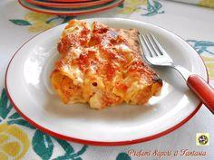 Cannelloni al prosciutto cotto ricotta e mascarpone, un primo piatto ricco, ma leggero, avendo sostituito la besciamella con salsa di pomodoro al basilico.