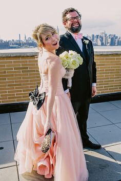 pink dress black bow, wedding in a theater, groom planned wedding, the modern wedding, @Offbeat Bride