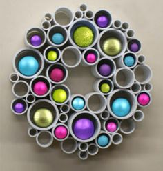 How to Use PVC Pipe for a Recycled Art Wreath. Watch the video and learn how to use PVC pipe for a modern take on wreath ideas using recycled materials. Thanks to Etsy Shop 'Red Sketch Door' for letting us feature! Pvc Pipe Crafts, Pvc Pipe Projects, Pipe Cleaner Projects, Lathe Projects, Holiday Wreaths, Holiday Crafts, Christmas Projects, Christmas Crafts, Xmas