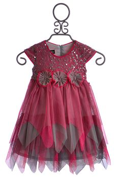 Suited for a fairy princess, this new designer little girls dress from Isobella and Chloe is a beautiful creation that will be adored at first sight! The empire bodice features cap sleeves and a sweet sequin decoration that accents the front. A hidden zipper runs up the back while three fabric flowers sit on the waist. The skirt is created with layers of sheer fabric in various colors. The fairy hemline is a magical design. 100% Polyester. Dry Clean Only.