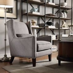 A sophisticated addition to your living room or den seating group, this wingback arm chair showcases silver nailhead trim for a touch of timeless style.