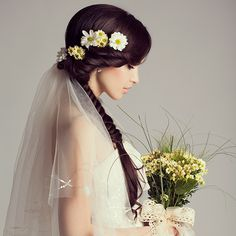 Stunning floral plait wedding hair idea. More for brides and guests alike over on http://www.goodhousekeeping.co.uk/fashion-beauty/hair-advice/best-wedding-hair-ideas-for-brides-and-guests