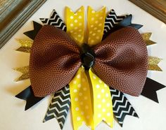 Football Cheer Bow Made From Real Football by CharacterBowtiqueTH on Etsy https://www.etsy.com/listing/235517617/football-cheer-bow-made-from-real