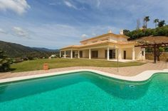 Beautiful positioned villa with spectacular views towards the Mediterranean, the mountains and the coast. South facing and private. Marbella Real Estate, Property For Sale, Swimming Pools, Spain, Villa, Mansions, Luxury, House Styles, Beautiful