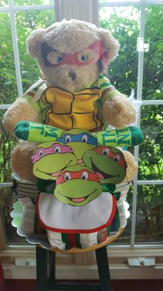Ninja Turtle Tricycle Diaper Cake Made ByNorma's Unique Gift Baskets.$75