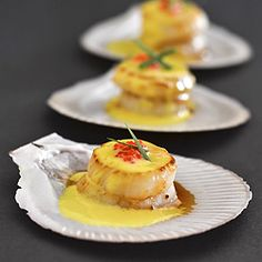 Fresh, sweet and delicate seared scallops in saffron and lemon infused creamy sauce