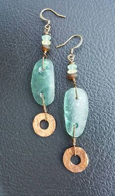Check out this item in my Etsy shop https://www.etsy.com/listing/482791321/ancient-roman-glass-earrings-artifact