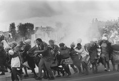 World Press Association Photo of the Year 1977 - Police throw tear-gas at a group of chanting residents of the Modderdam squatter camp protesting against the demolition of their homes outside Cape Town. U2 Music, World Press Photo, North Caroline, Photo Awards, World History, Photojournalism, Photo Contest, Historical Photos, Cape Town