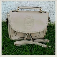 New PU Leather Vintage Top Handle Beige Bag New British style PU Leather Shoulder Crossbody Messenger Bag! This bag is great for anyone who loves the preppy vintage look! Comes with matching shoulder straps!  This bag does have a few spots with grey stains. please refer to the pictures. Other than that, it's gorgeous!   - Measurements:height is roughly 8.5 inches, length is roughly 10.5 inches, and width is roughly 4.5 inches. - No swaps.  No returns.  UNBRANDED.  NWOT! Bags