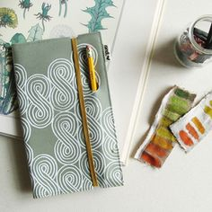 Large notebook with pencil slot. love design to utilize for a 3 ring binder/planner.