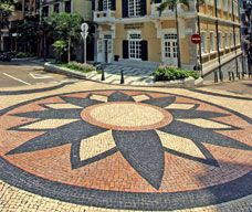 Macau Government Tourist Office: St. Augustine's Square gathers various classified buildings, such as St. Augustine's Church, Dom Pedro V Theatre, St. Joseph's Seminary and Sir Robert Ho Tung Library. The cobblestone pavement unifies the area and reflects a traditionally Portuguese streetscape