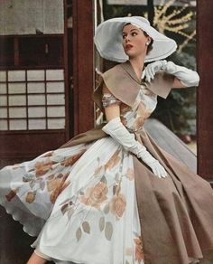 Model wearing a floral gown by Madame Grès, 1953.
