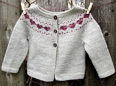 Little Hearts is a simple baby cardigan that features a sweet colorwork heart yoke detail.