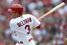 St. Louis Cardinals' Carlos Beltran hits his second home run of a baseball game during the fourth against the Washington Nationals Sunday, Sept. 30, 2012, in St. Louis.
