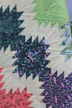 Close-up of machine quilted lines on delectable mountain blocks.