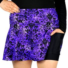 """SparkleTech SwingStyle Haunted SparkleSkirts' first in-house-designed print! The medium-weight spooky fabric tops black wicking, anti-microbial, anti-ride undershorts that hold our famous 5X5"""" pockets.  The 12"""" zippered pocket in the waistband safely holds valuables and can be worn front or back!  Note: The compression of the Haunted fabric may feel a little tighter than other SparkleTechs in your size, but it is a nice, breathable fabric!"""
