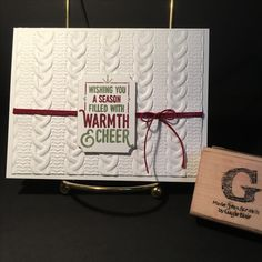 WRAPPED IN WARMTH from the 2016 holiday catalog. Card stock is Whisper White THICK. Ink colors Cherry Cobbler & Wild Wasabi. Tags & Labels Framelits. TIEF Cable Knit. Bakers Twine Trio pack. All supplies & images by Stampin'Up!