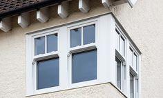 White uPVC Sash bay window with sash horns