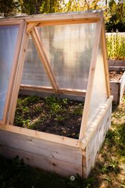 I love this idea of a mobile greenhouse cover for raised garden beds.  We want to do something like this in front of our house.