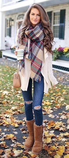 #fall #outfits women's white cardigan, scarf, blue jeans, and brown boots