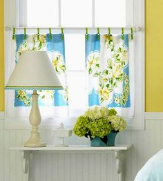Cute tab top curtains made from vintage tea towels.