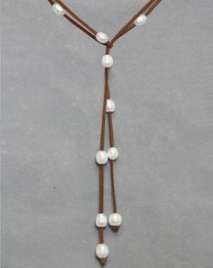 Fresh Water Pearl Lariat Necklace in Tan ~ Hip, modern and oh so affordable - you'll want to keep several of these on hand as gifts! Lariat style Fresh Water Pearl Necklace, strung on Black Suede, has multiple personalities. Change the design to suit your mood, by moving the pearls and tying in different ways. $25