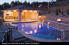 Beautiful pool love the connected pool house all they need is some loungers! Rugged Class Waterfalls & Pools