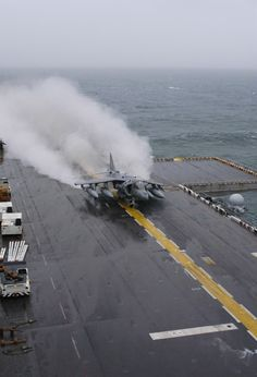 Harrier assigned to Marine Attack Squadron Two Three One (VMA-231) launches from the flight deck of the amphibious assault ship USS Bataan (LHD 5).