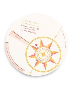 Direct guests to your wedding with this fun compass-inspired card that helps them find reasons to attend: When they spin the bottom portion of the card, they'll see all the activities they'll be enjoying (dancing! feasting! toasting!).