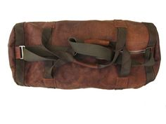 A classic full genuine Perfect for any serious travels! Woodlands Brown and Olive Straps.