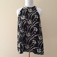 """Elizabeth and James Etta Top Last chance!  Closet closing Nov 1!  🌟Original list price was $160!🌟 NWT!  Elizabeth and James Etta top.  This beautiful silk top has an all-over large scale white floral pattern on a black background.  White beading detail at neck.  Keyhole opening at back of neck.  Length: 26.5"""".  100% silk.  ✨Reasonable offers welcome.✨ Elizabeth and James Tops"""