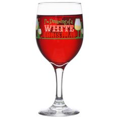 """Raise your glass and offer a toast at your next holiday gathering! Lovely festive wine glasses are decorated with """"I'm Dreaming of a White Christmas"""" printed around the bowl. Perfect for"""